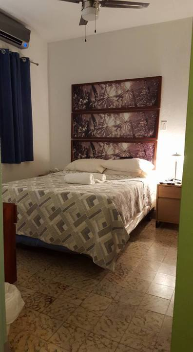 The cozy, comfy bedroom in our Ocean Park apartment minutes from a quiet San Juan beach