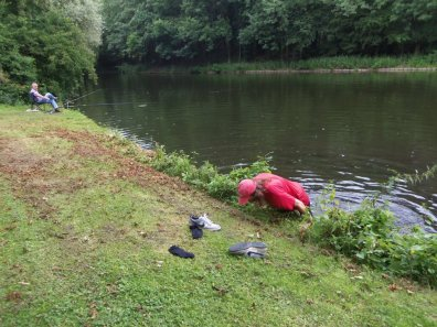 While in Holland, we went to a local disc golf park and one of my bro's discs ended up in the water; he retrieved it.