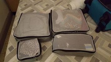 Trying to cram your life into suitcases.