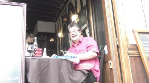 My dad eating escargot in Paris (BLEGH!)