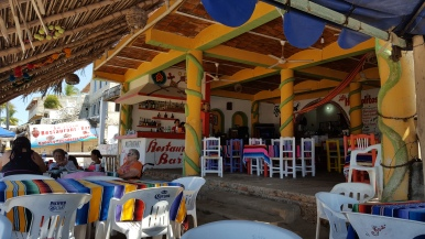 "Beach bar in Guayabitos.... I wish I'd taken a photo of the bathrooms here. So mad I forgot to. The toilets didn't have any water in them. There was a big rain barrel with a house outside of the ""room"" where the toilet was (more like a closet)."