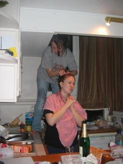 A friend dyes my hair red for the first time, in my first apartment.