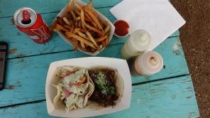 Delicious tacos and garlic fries at Mellizoz taco truck