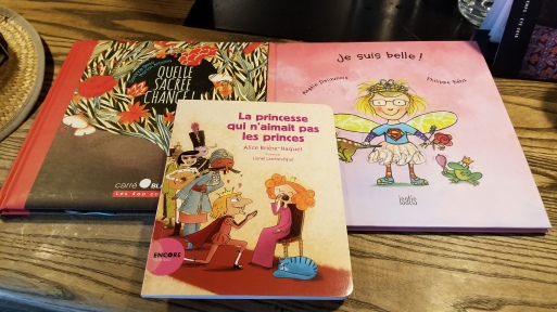 The three French kids books I bought: one about recognizing your own beauty even at your worst; one is about the incredible chance that goes into our creation (if our parents hadn't fallen in love, or if they hadn't even met, and if they're parents hadn't met...); and one about the princess who didn't like princes (hint: she likes fairies).