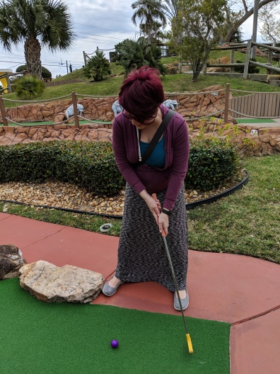 I totally kicked his butt at putt putt!