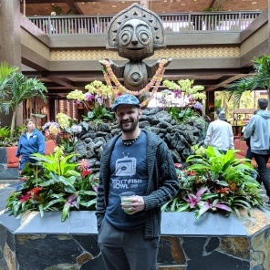 Walking around the Polynesian with a blue tiki drink!